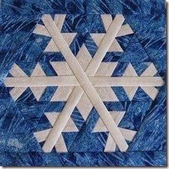 Snowflake 7 paper pieced quilt block. Pattern available at https://payhip.com/CanuckQuilterDesigns