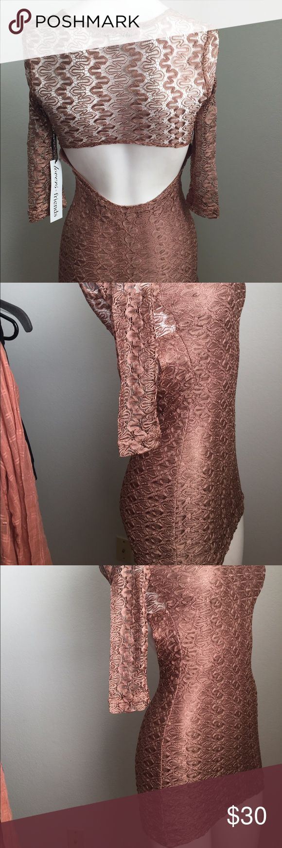Gorgeous beige lace dress with cutout The perfect date dress! U-Neck Long Sleeve Cutout Back Slip On Partially Lined Measures Approximately 22'' Long From Natural Waist; Self: 60% Nylon / 30% Cotton / 10% Spandex; Lining: 100% Cotton Lovers + Friends Dresses