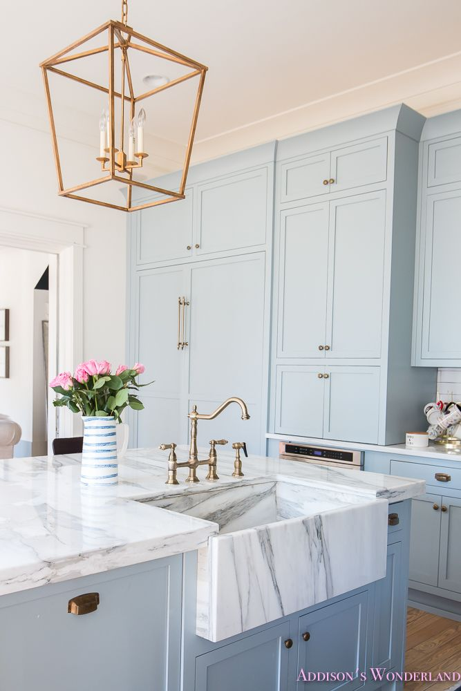 Tour Our Colorful & Whimsical 1905 Historic Home Wonderland... Sharing a FULL TOUR of our current home along with details on every single room! kitchen-powder-blue-gray-cabinet-color-white-marble-countertops-calcutta-gold-farmhouse-apron-sink-modern-vintage-gold-brass-bridge-faucet-darlana-gold-lantern