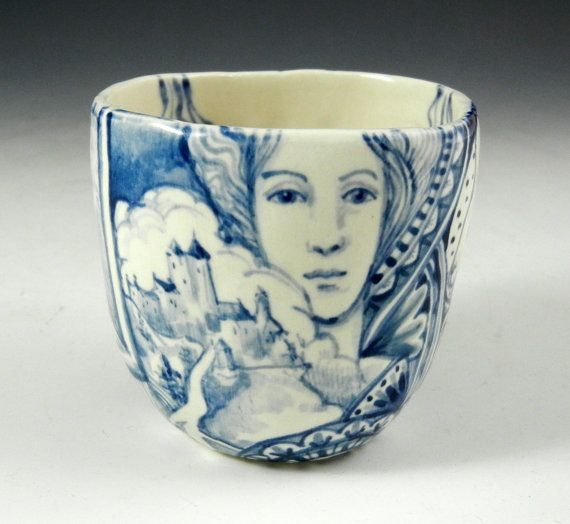 Blue and white porcelain hand painted story cup with faces, rabbit, eye, castle and imagine