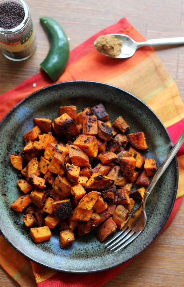 Sweet potatoes get a spicy makeover when they're tossed with a mix of turmeric, garam masala, and red pepper flakes in this recipe for North Indian-spiced roasted sweet potatoes.
