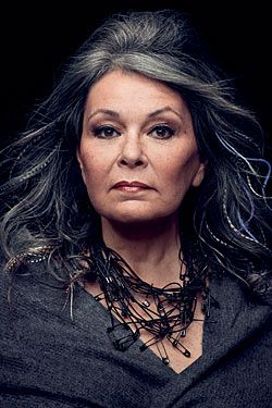Roseanne rocks this photo. The gray hair, the makeup, the great FACE, and the amazing safety pin necklace.
