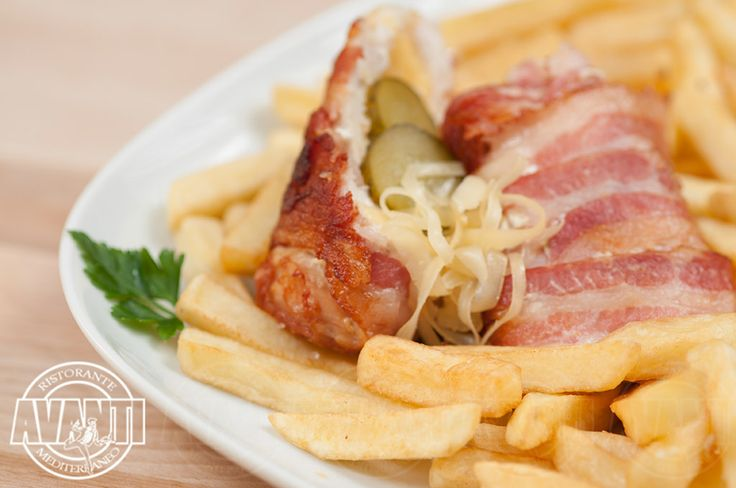 Pollo speciale (chicken breast rolled up with bacon and cheese, stuffed with pickled cucumber, with French fries)