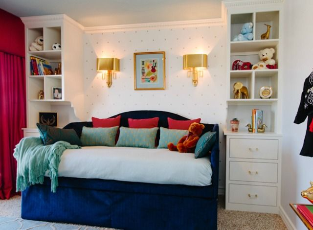 Check out a modern boy's bedroom design from Little Crown Interiors that features an upholstered daybed, custom built-ins and a subtle music theme.