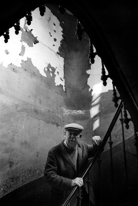 Ara Guler Jean RENOIR on the stairs of his home.