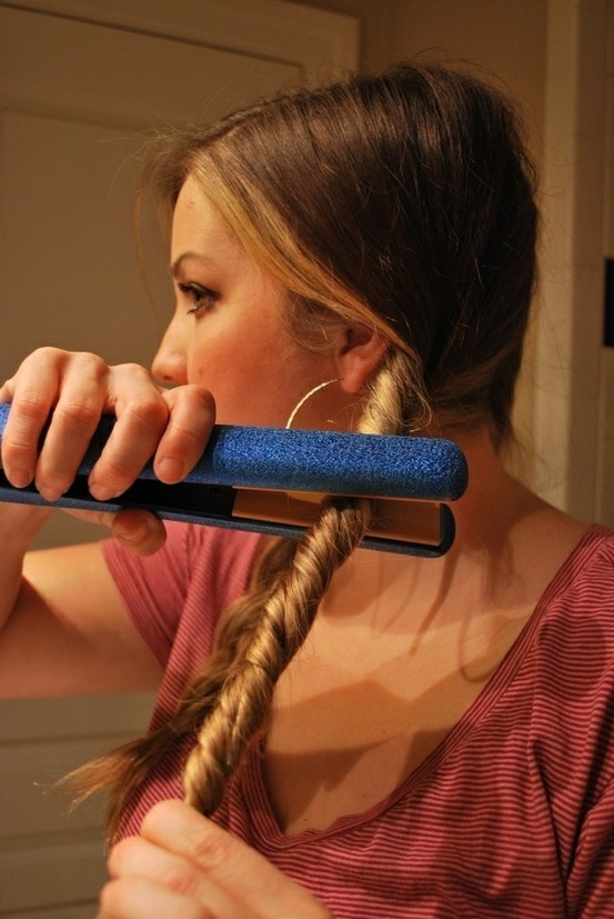 Split and braid your hair into two sections and tie with a rubberband. Twist the braid away from your face and then twist the flat iron onto your hair in the same direction your hair is twisted. Do not touch rubberband or else you will get that weird crease. Repeat this process twice! After hair is cooled, then take them out and run your fingers through braid. It gives you nice beachy waves!