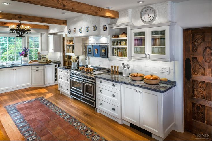 white decorative tile  | Mediterranean-style kitchen with transitional white ...