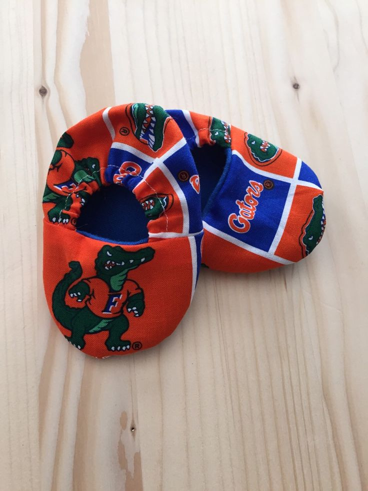 Cloth Baby Shoes / Baby Crib Shoes / University of Florida Gators Pattern / Sizes: Newborn - 9 Months by craftinistagirl on Etsy https://www.etsy.com/listing/246055719/cloth-baby-shoes-baby-crib-shoes