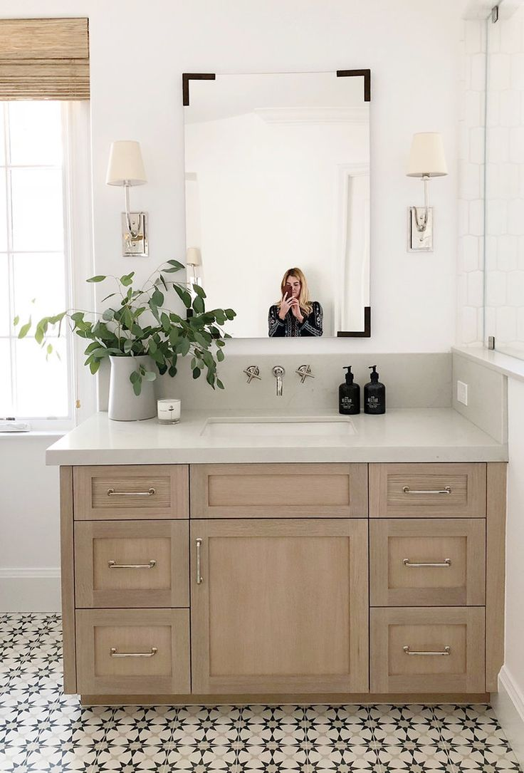 Studio McGee bathroom design —weathered wood vanity, fun tile floor