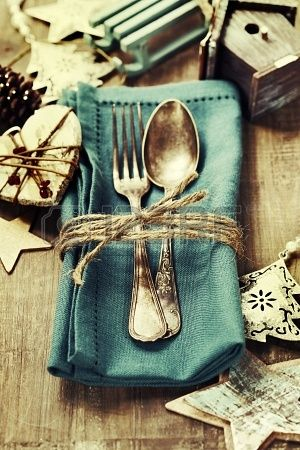 Christmas table place setting with Christmas decorations and twine. Love the vintage feel!