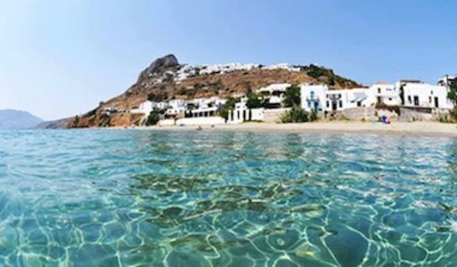 Panoramic view of Magazia Beach (main sandy beach) below the old town of Skyros, Greece.