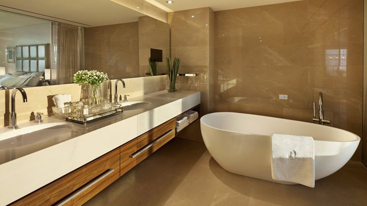 The Ritz-Carlton, Herzliya - Modern and elegant, guest bathrooms offer a quiet oasis for indulgence with customized Asprey amenities, a plush bathrobe and slippers