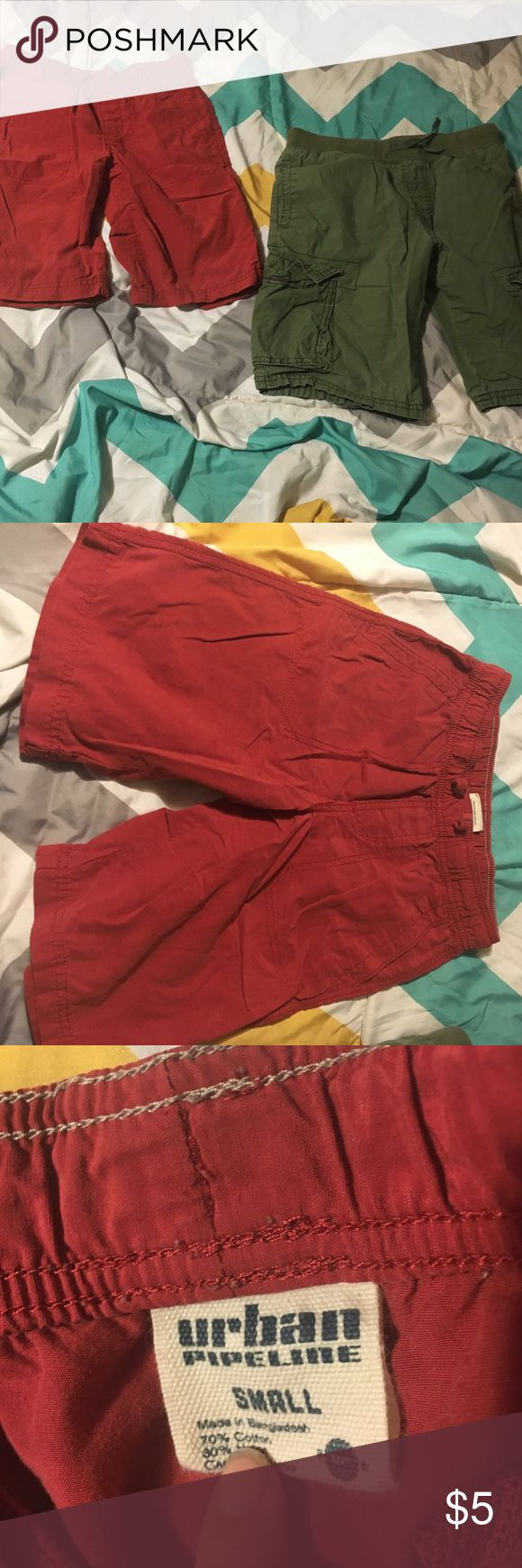 Boys cargo shorts 2 pair Red pair is boys small but fits like the green pair which is a medium. The red is urban pipeline and the green is old navy Bottoms Shorts