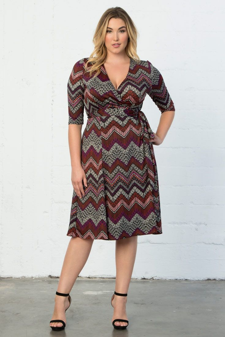 Our plus size Essential Wrap Dress is now available in a multi-pink and black chevron print. Shop our entire made in the USA collection online at www.kiyonna.com.