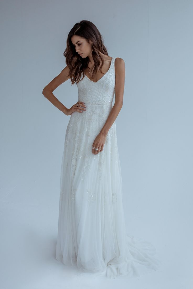 KAREN WILLIS HOMES // ONE & ONLY BRIDAL // 'Beatrice' is for the bride that loves romance; this a-line wedding dress is fully beaded, which adds subtle sparkle to your special day.