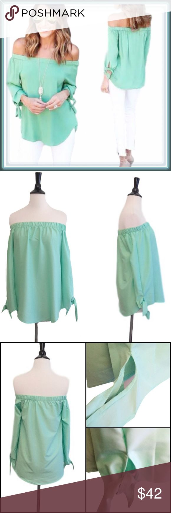 "Off the shoulder mint green long sleeve top ➖SIZE: Medium     ➖BUST: 17.5""     ➖LENGTH: 18"" from the top hem to the bottom.  ➖STYLE: An off the shoulder (has material that holds it in that style when on) with sleeves where at the end, there are two pieces that tie into a bow / knot it - whatever you choose to do with it. ❌NO TRADE Tops Blouses"