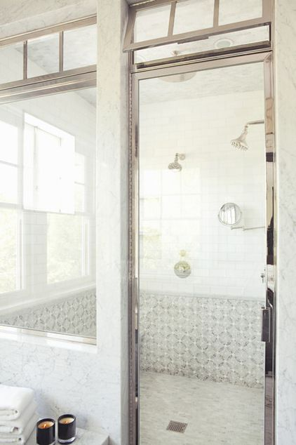 Adjustable panels at the top allow for venting in this fully enclosed shower as well as give it a little flair.