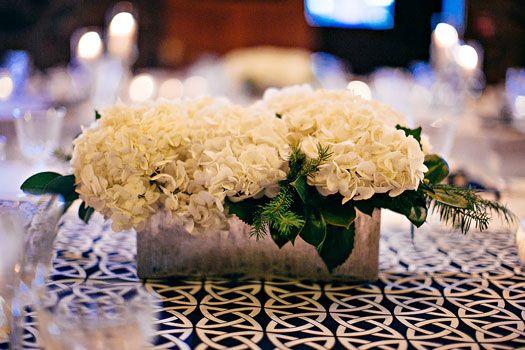White hydrangeas in long rectangular mercury glass vases