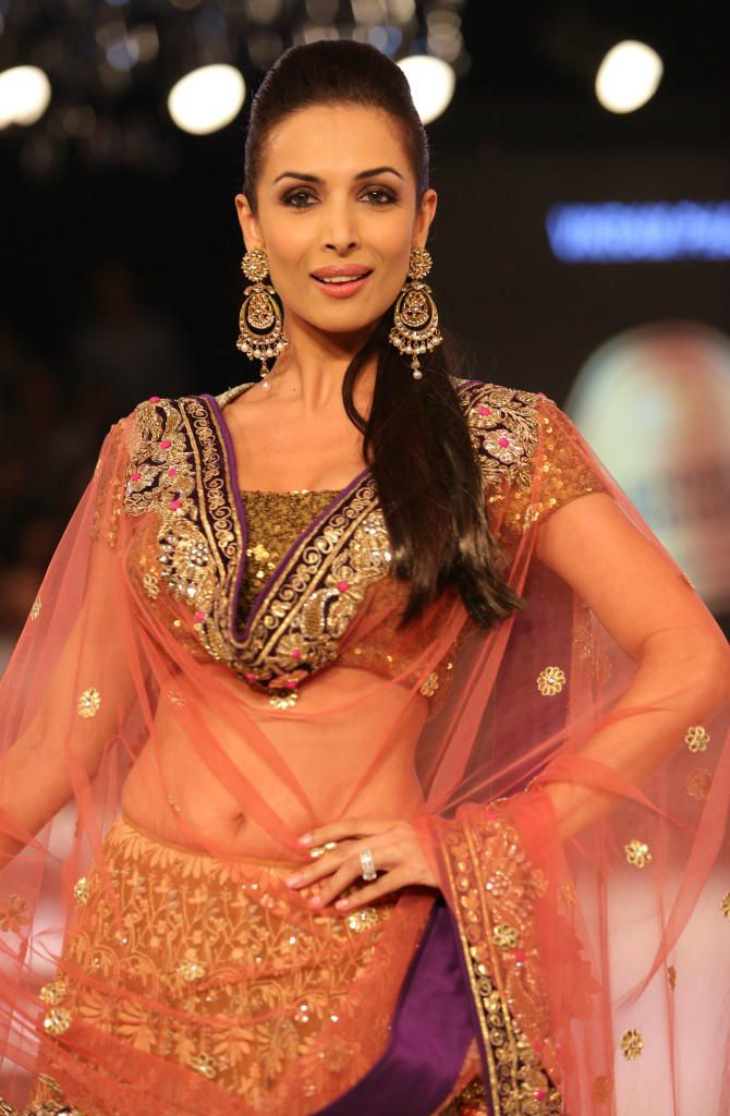 "God created Malaika and then coined the words ""oomph"" and ""panache"". At BPFT 2012 for Vikram Phadnis"