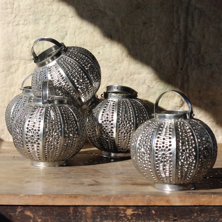Kora perforated metal ball tea light lantern