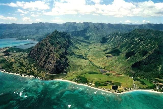Kualoa Ranch!  My high school had a high ropes course in the back of this valley that I got to help run a few times a year.  This is also where Lost, Jurassic Park, etc were all filmed.