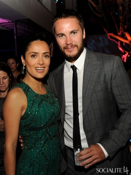 """Actress Salma Hayek (L) and actor Taylor Kitsch pose at the after party for the premiere of Universal Pictures' """"Savages"""" at the Armand Hammer Museum on June 25, 2012 in Los Angeles, California"""