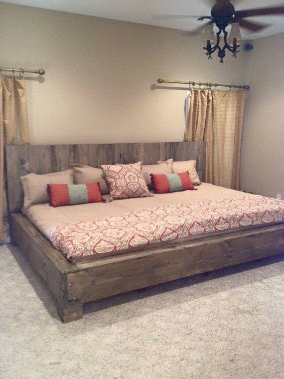 Love this bed. Made out of old barn wood!