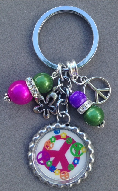 This listing is for one Peace sign bottle cap key chain.  This key chain is very colorful and fun. It is decorated with pink, green and purple beads, a peace charm and a groovy flower charm.  This will come to you in an organza gift bag ready to give as a gift or to keep for yourself.  Have...