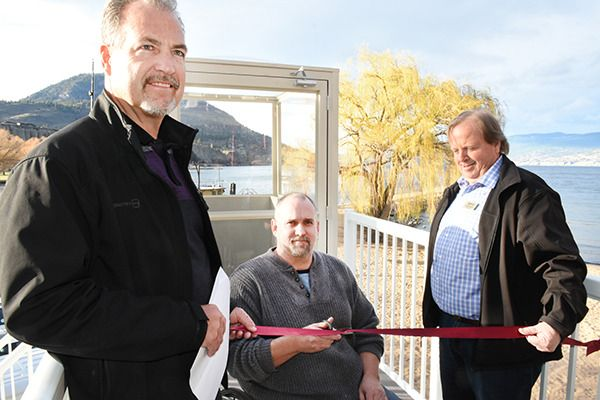 James Hark prepares to cut the ribbon with Jim Cooper, left, and Coun. Andre…