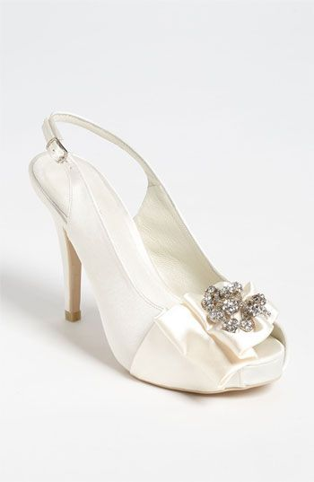 Free shipping and returns on Menbur Slingback Pump at Nordstrom.com. A sparkling starburst of crystallized cornucopias steals the spotlight on a satin slingback pump perfected with a partially concealed platform.