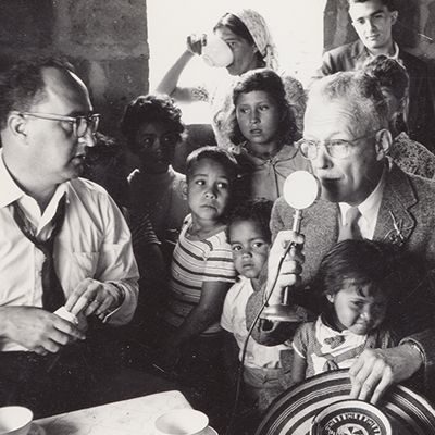 Hector Abad Gomez and Dr. Richard Saunders with the children of the community of Versailles, Medellin, 1961