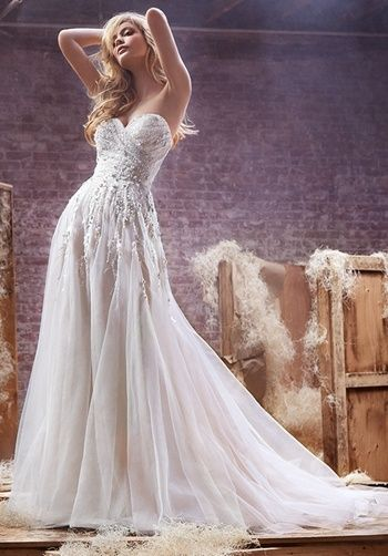 Alabaster tulle A-line bridal gown, with crystal encrusted bodice and skirt, sweetheart neckline and