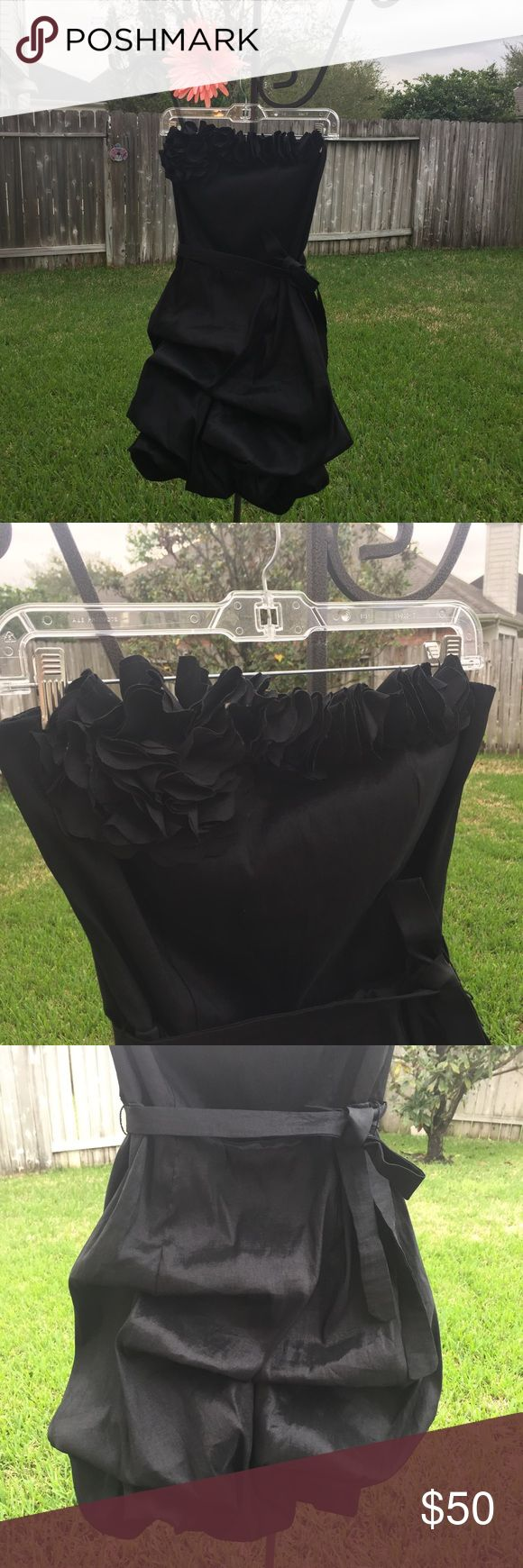 "Black Strapless Formal Polyester/Nylon/Spandex blend BEAUTIFUL black formal ""poof"" dress! Two small tears hidden behind flouncy breast embellishment (see pics). Absolutely gorgeous, near new! Machine washable, even. Snap Dresses Strapless"