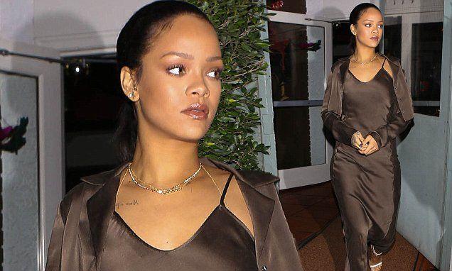 Rihanna flatters her curves in a slinky satin slip dress
