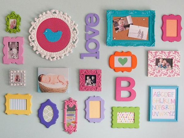 Can dislplay the girls artwork in frames and then have there initials on the wall Love this idea!