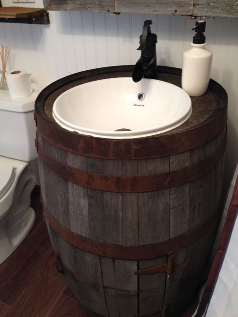 A rustic barrel vanity is just one of the surprises you'll find in this amazing bathroom makeover.