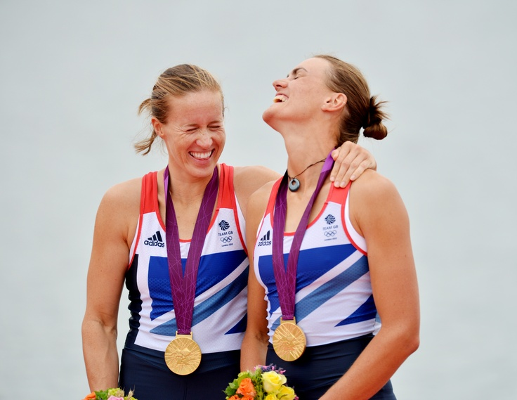 "Today's Olympic picture of the day. Picture editor Jessica Mann says: ""It has to be the excitment and the elation of Helen Glover, left, and Heather Stanning, who were the first to win a Gold Medal for Great Britain today at Eton Dorney Lake. Here they are on the platform receiving their medal."""