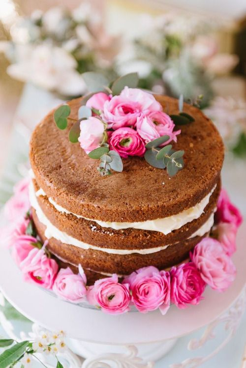 Layered Naked Cake with Jam and Cream Cheese Frosting + Decorated with: Pink Renaculus, Eucalyptus Sprigs, and Surrounded by Pink Roses or Renaculus! ||| Cute cake for a Garden Party