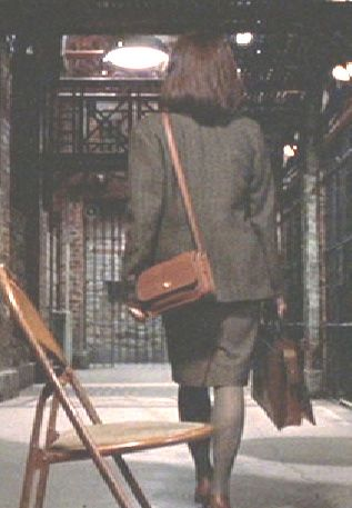 Clarice Starling with her good bag offsetting her cheap shoes, gleefully pointed out to her by Hannibal.