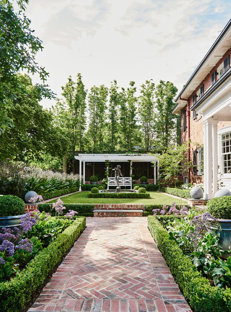 Manicured gardens with brick pathways surround this renovated 1930s Georgian home. Photography: Lisa Cohen | Story: Belle