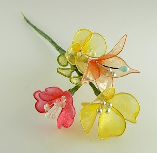 Wire looped acrylic gelatin dipped craft flowers. Made these in VBS.