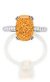 VERY RARE AND EXQUISITE FANCY VIVID ORANGE DIAMOND AND DIAMOND RING Simply set with a cushion-shaped fancy vivid orange diamond weighing 4.19 carats, to a shank set throughout with brilliant-cut diamonds, mounted in 18 karat white gold.
