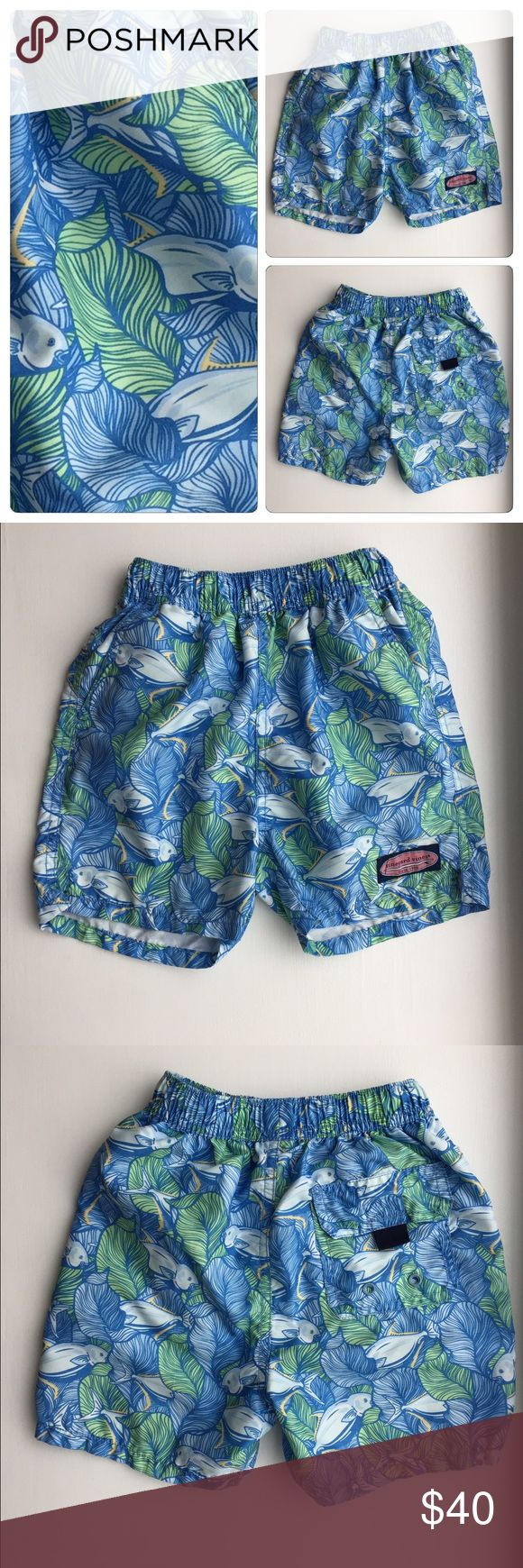 Vineyard Vines Swim Trunks Adorable, preppy VV fish swim trunks! Green, blue, white and yellow pattern. Elastic waistband, mesh underwear and drawstring inside of trunks to tighten shorts. In excellent condition! Vineyard Vines Swim Swim Trunks