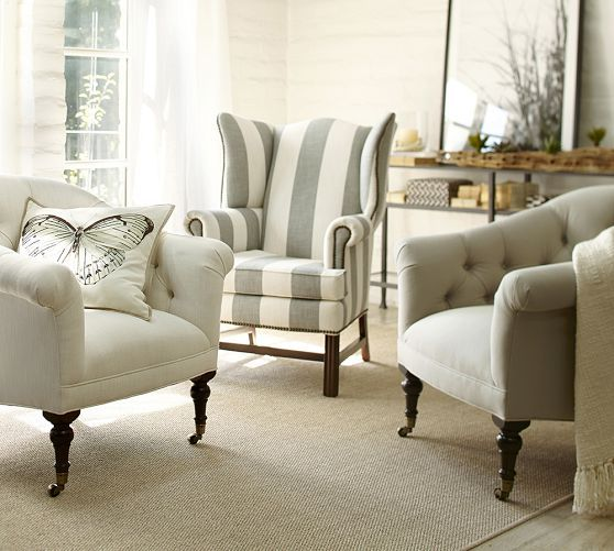 I love a good wingback chair, so classy looking - Thatcher Upholstered Wingback Chair | Pottery Barn