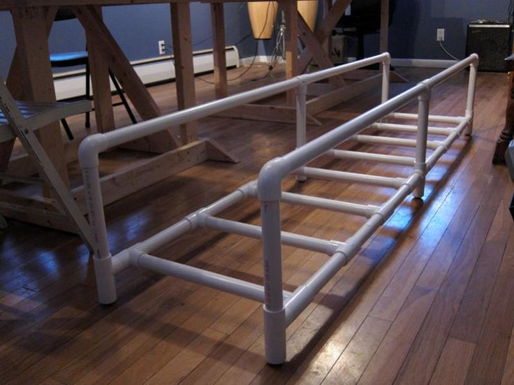 Dog Agility Ladder. I like the rails to encourage straightness, plus you could adjust the height by sliding the ladder up the rails