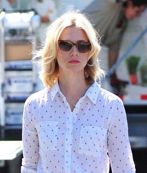 January Jones -- sunglasses, shirt.