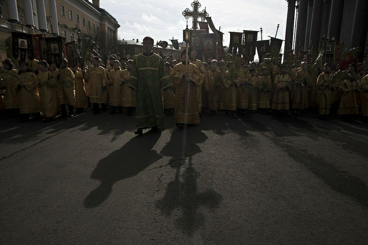 Orthodox christians believers takes part in a Palm Sunday procession
