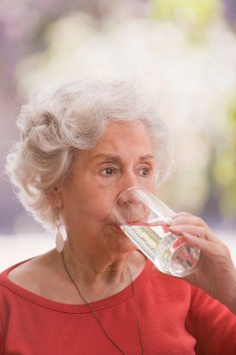 Senior Chilean Woman Drinking Water Foto de stock 136802169
