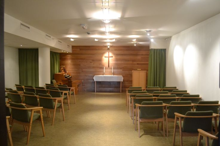 This chapel in the basement of a Retirement Home looks was given (among other things) lights in the ceiling in the shape of a cross.