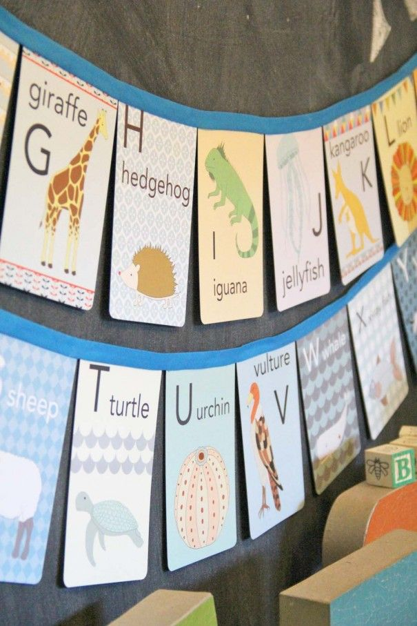 DIY flashcard alphabet banner using bias tape and hot glue. #babyshower #decor